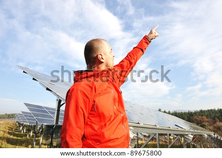 Male engineer at work place pointing by finger - stock photo