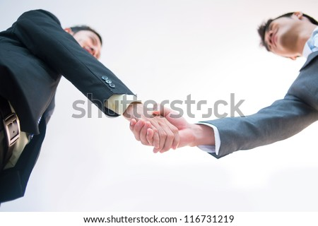 Male entrepreneurs greeting each other to lay the foundation for fruitful cooperation - stock photo