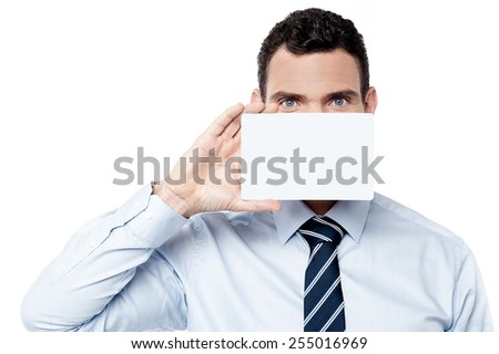 Male executive cover his face with blank card - stock photo