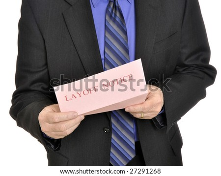 Male executive receiving the pink slip layoff notice - stock photo