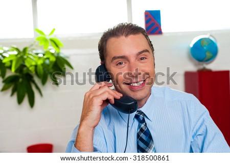 Male executive talking on phone - stock photo