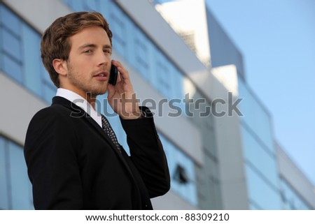Male executive using a cellphone - stock photo
