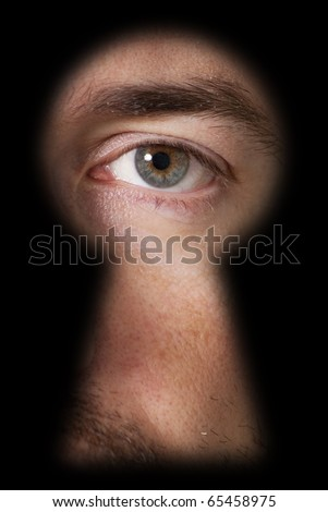 Male eye, looking through a blurry black keyhole - stock photo