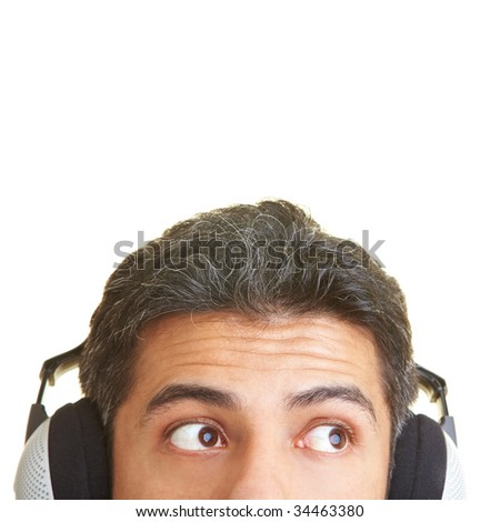 Male face with headphones looking to the side