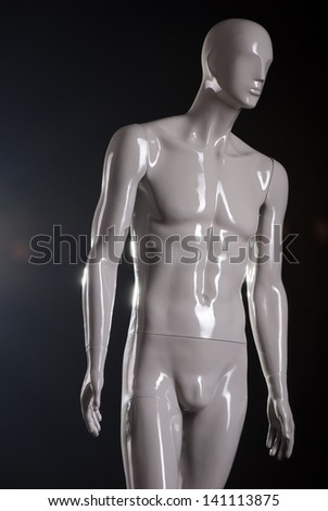 Male fashion mannequin against a black background