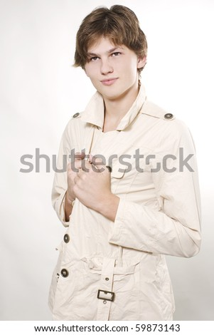 Male fashion model wearing overalls posing in studio - stock photo