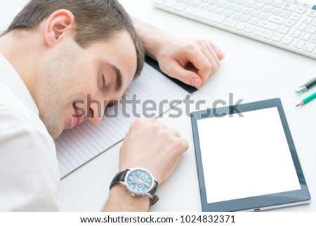 male fell asleep on the desktop, work at night, top view