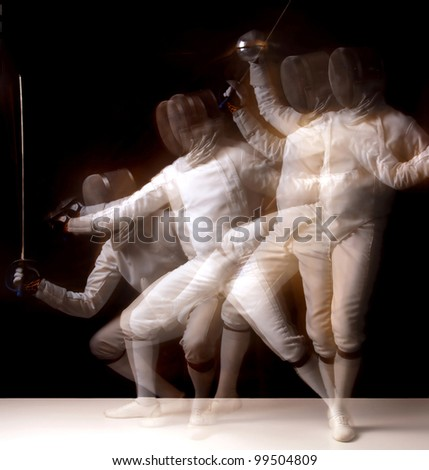 Male fencer isolated in a dark background