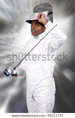 Male fencer removing his mask - stock photo