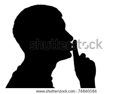 Male figure in silhouette gesturing for quiet...  Shhhhh - stock photo