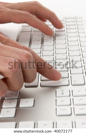 male fingers pressing computer keys at workplace