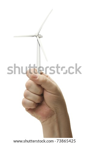 Male Fist Holding Wind Turbine Isolated on a White Background. - stock photo