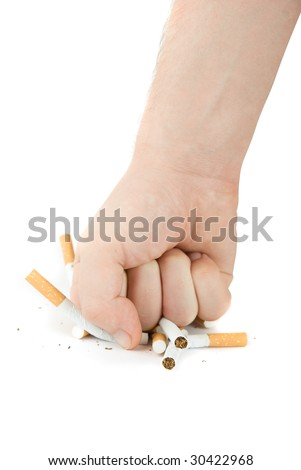 male fist with many cigarettes isolated on white - stock photo