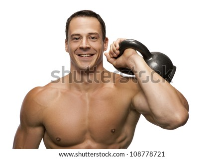 Male  fitness model holds a kettlebell - stock photo