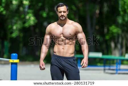 Male fitness model posing  - stock photo