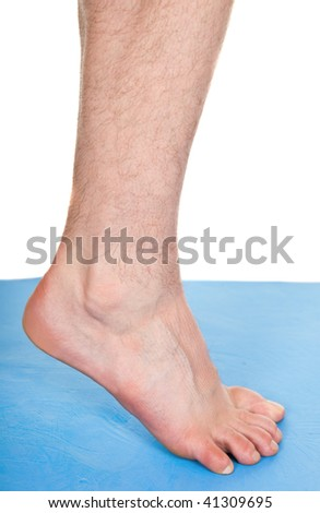 male foot on blue mat - stock photo