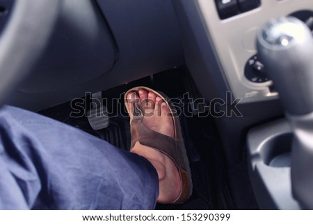 Male foot on the pedal of a car - stock photo