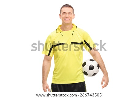 Male football referee in a yellow jersey holding a ball and looking at camera isolated on white background - stock photo