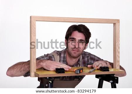 Male framer - stock photo