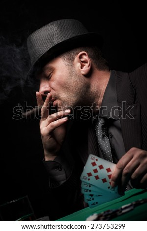 Male gambler playing poker. - stock photo