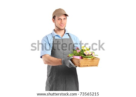 Male gardener holding a basket with flower pots isolated on white background - stock photo