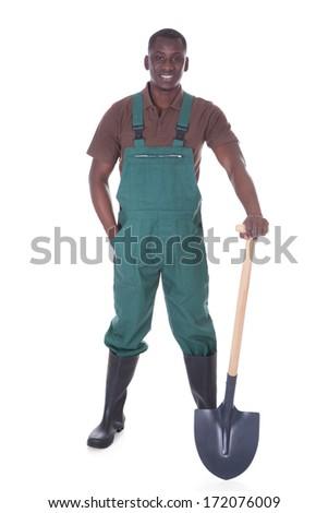 Male Gardener Holding Shovel Over White Background - stock photo