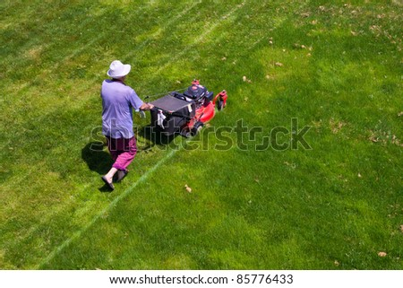 male gardener working with lawn mower