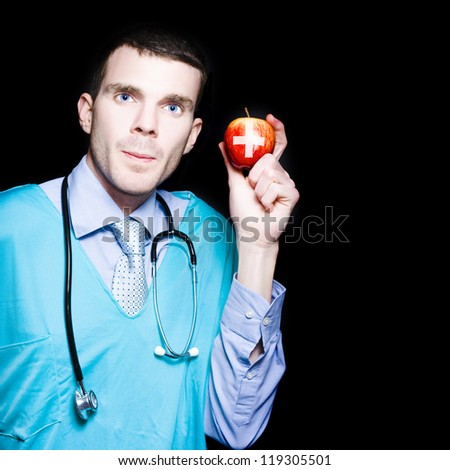 Male Gastroenterologist Doctor Holding An Apple With Medical Cross In A Depiction Of An Apple A Day Keeps Constipation Away - stock photo