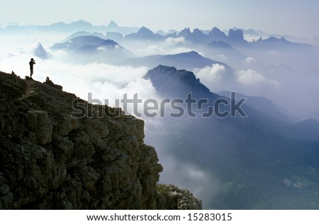 Male gazing at stunning mountain vista - stock photo