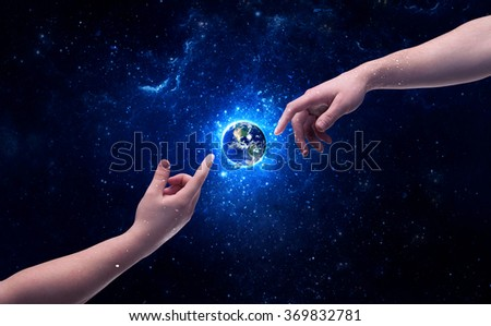 Male god hands about to touch the earth globe in the galaxy with bright shining stars and blue light illustration concept. Elements of this image furnished by NASA. - stock photo