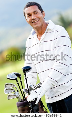 Male golf player with a sack at the course - stock photo