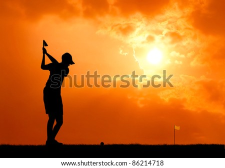 male golfer aim at golf ball at sunset silhouetted - stock photo