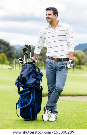Male golfer at the course with a golf sack  - stock photo