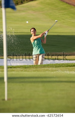 Male Golfer Playing Bunker Shot On Golf Course - stock photo