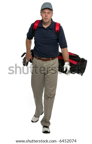 Male golfer walking along carrying his bag. - stock photo