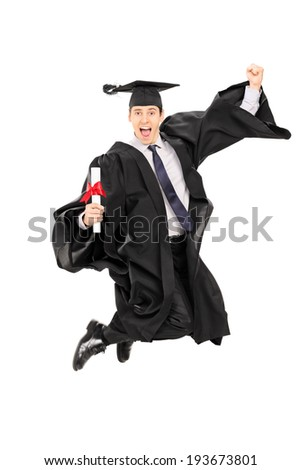 Male graduate student jumping out of joy isolated on white background - stock photo