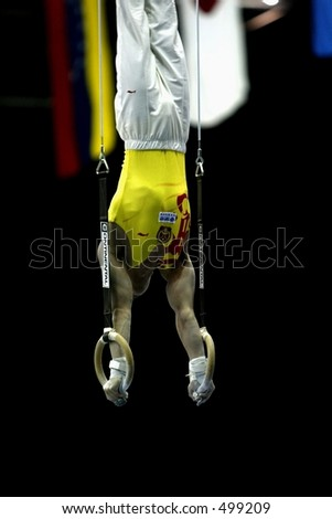 male gymnast on rings - stock photo