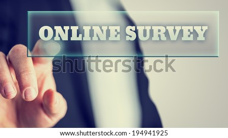 Male hand activating an Online survey button on virtual screen. - stock photo