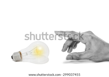 Male hand and the light bulb isolated on white. concept = Energy saving before too late - stock photo