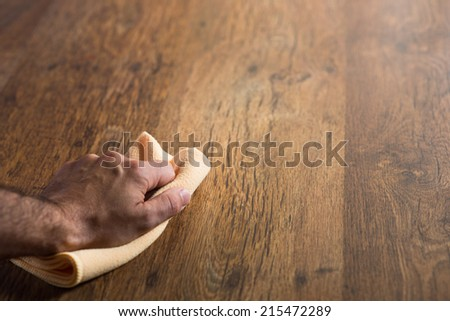 Male Hand Cleaning And Rubbing An Hardwood Floor With A