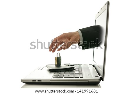 Male hand coming out of laptop monitor trying to steal ones wallet only to find it under padlock. - stock photo