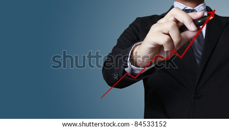 Male hand drawing a graph - stock photo