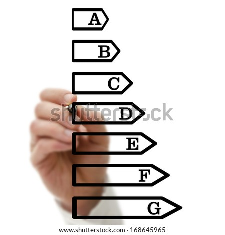 Male hand drawing energetic efficiency scale on virtual screen. - stock photo