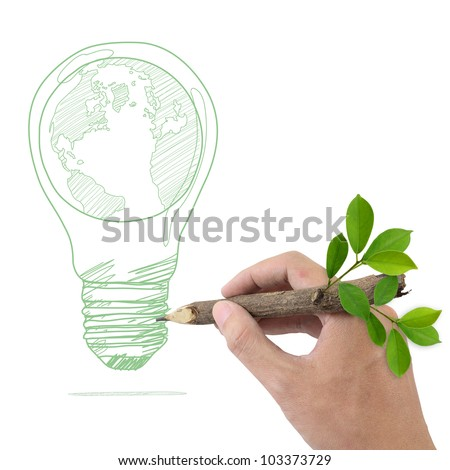 Male hand drawing Globe in a light bulb. - stock photo