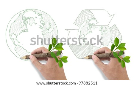 Male hand drawing recycle and world symbol. - stock photo