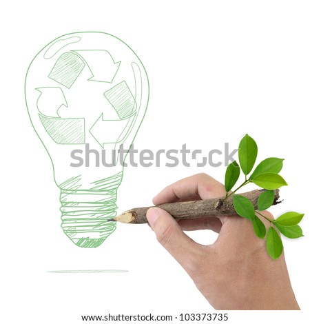 Male hand drawing recycle symbol in a light bulb. - stock photo