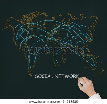 male hand drawing social network link on world map - stock photo