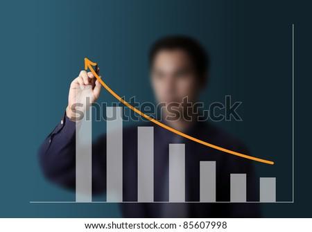 male hand drawing upward trend graph - stock photo
