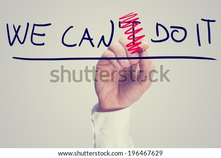 Male hand erasing letter T from a phrase We can't do it. Positivity and determination concept. - stock photo