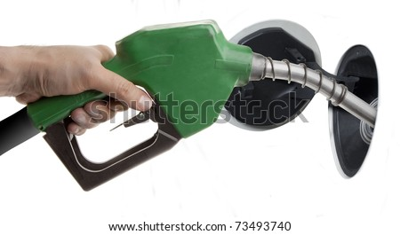Male hand filling gas isolated on white - stock photo